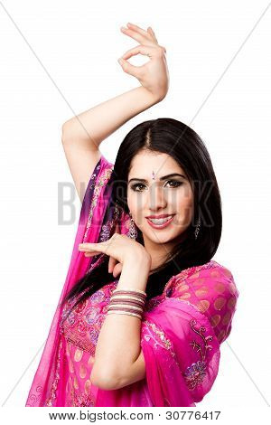 Happy smiling beautiful Bengali Indian Hindu woman in colorful dress in dance pose isolated stock photo