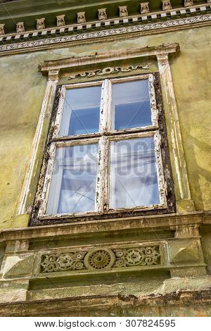 Architectural detail of a beautiful old building at Piata Regele Ferdinand I or King Ferdinand I Square in Medias, Sibiu County, Transylvania, Romania stock photo