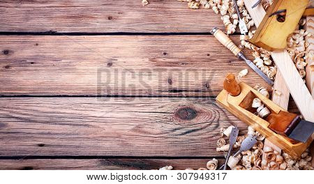 Wooden planer, natural building materials, free space, woodwork and antique hand tools, carrying out carpentry, tool kit for joinery, old wood texture stock photo