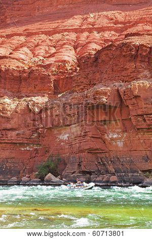 Sporting young woman on a kayak overcome rapid course of the colorado river