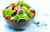 Salad. Greek Salad confined on a White Background. Mediterranean Salad with Feta Cheese, Tomatoes a
