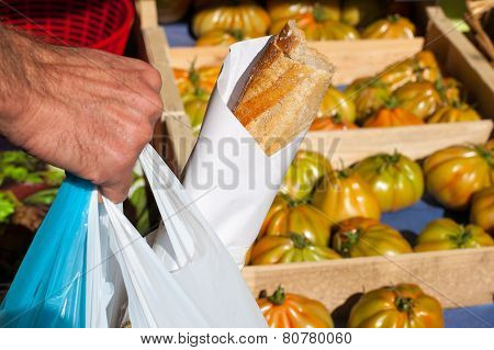 Man buying food on a local market with homegrown organic produce stock photo