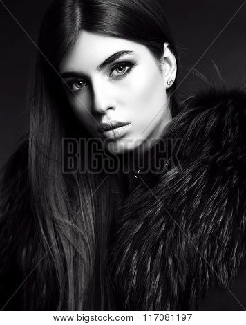fashion black and white studio photo of gorgeous sensual woman with dark straight hair wears elegant clothes and bijou stock photo