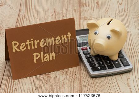 Having a retirement plan A golden piggy bank card and calculator on wood background with text Retirement Plan stock photo