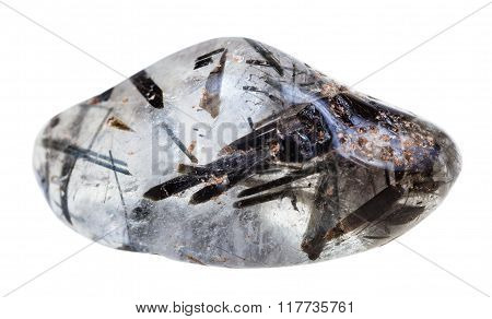 macro shooting of natural mineral stone - tumbled quartz with schorl (black tourmaline) crystals gemstone isolated on white background stock photo