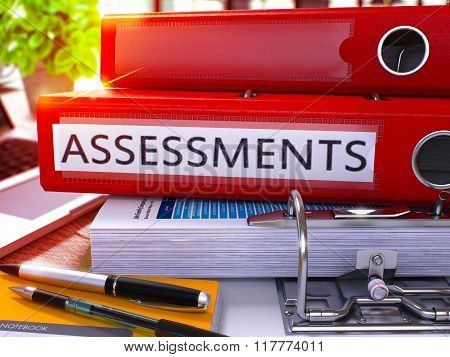 Red Office Folder with Inscription Assessments on Office Desktop with Office Supplies and Modern Laptop. Assessments Business Concept on Blurred Background. Assessments - Toned Image. 3D stock photo