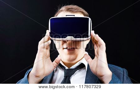 Businessman using his Virtual Reality VR glasses head mounted display stock photo