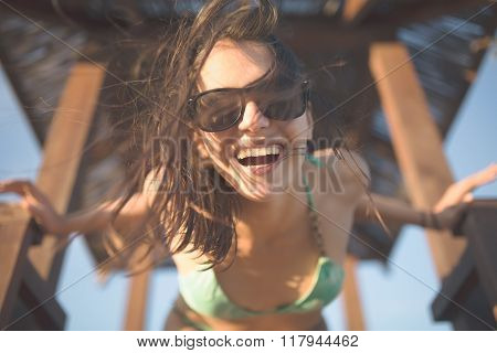 Attractive  fit woman enjoying summer.Beach Party.HappinesCarefree beautiful brunette with wet lo