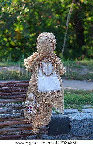 Ukrainian national folklore doll motanka on view. Retro stock photo
