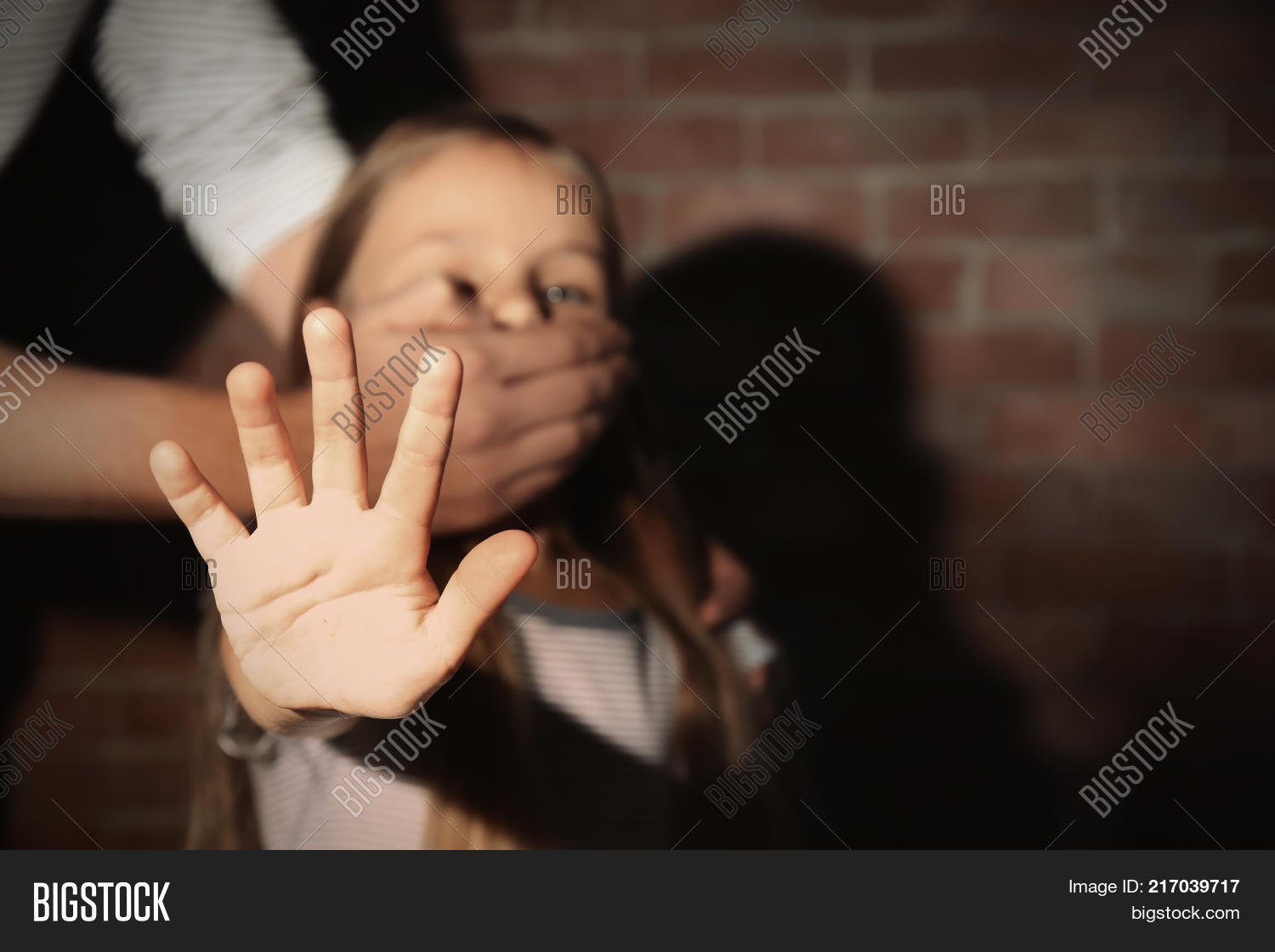 man u0026 39 s hand covering mouth of helpless little girl  abuse of children concept