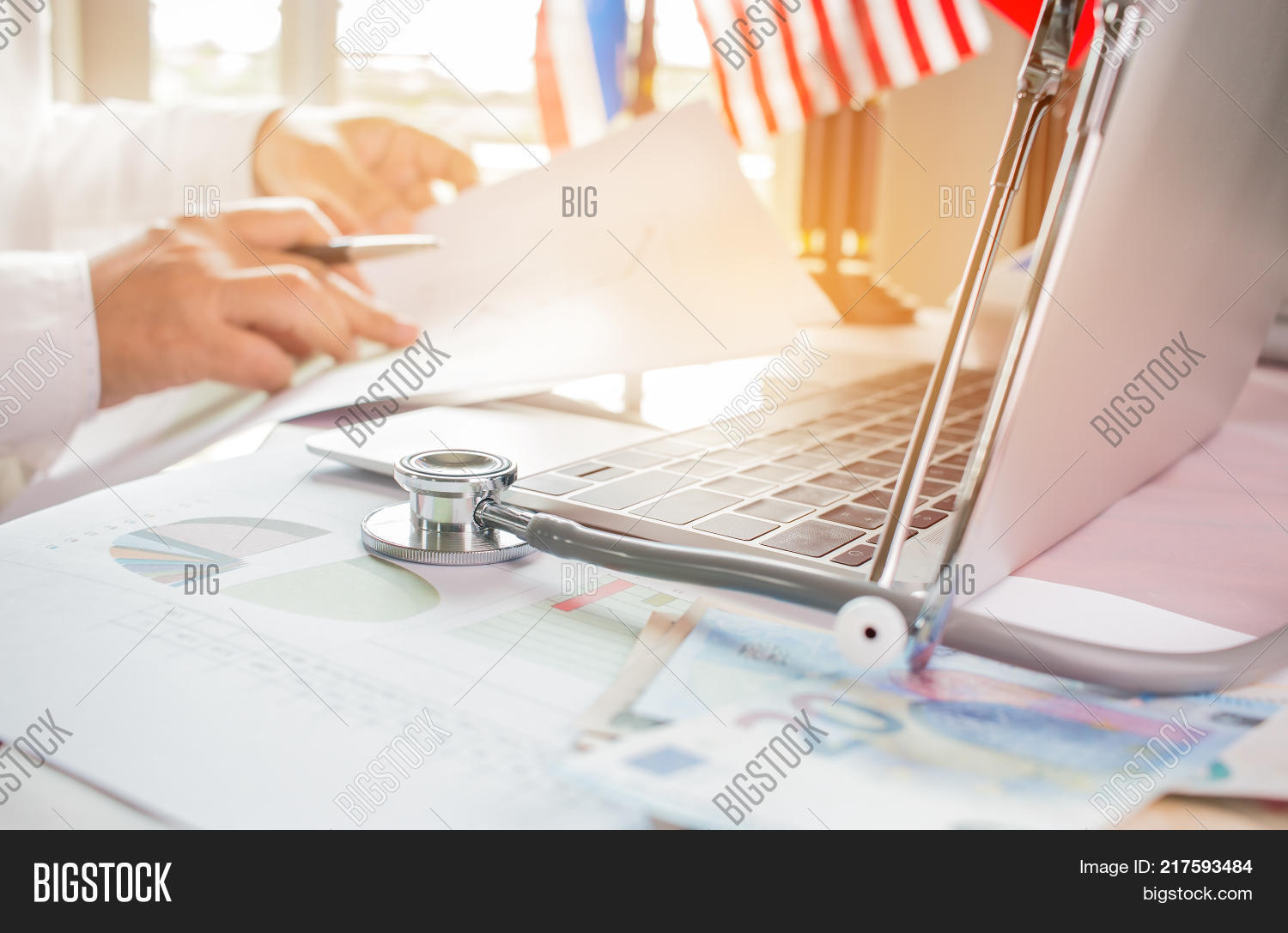 accounting,adult,analysis,background,business,businessman,care,caucasian,chart,clinic,computer,corporate,data,desk,doctor,document,executive,finance,financial,graph,health,healthcare,hospital,investment,laptop,male,management,manager,medical,medicine,metrics,notebook,office,officer,paperwork,partnership,physician,plan,professional,report,results,revenue,specialist,statistics,team,technology,workplace,young