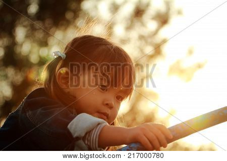 Japanese girl playing in the park at evening (3 years old) stock photo