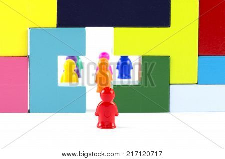 A conceptual image of the problem of autism. Barrier wall misunderstanding in society. Desire to help the autistic. A new look at the problem of autism. Society through the eyes of a person with an autism disorder. stock photo