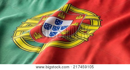 A Portuguese flag is seemingly waving in the wind. The Coat of Arms in between the bold red and green colors is a great symbol for the country of Portugal. stock photo