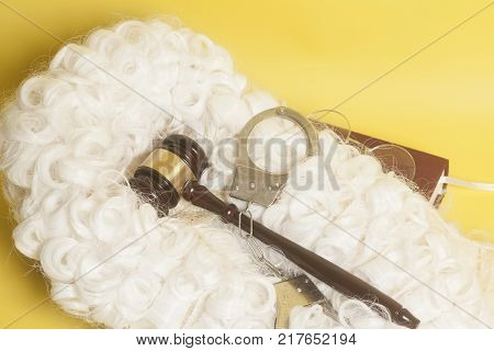 set for judge:judge wighandclufs judge gavelbook end eyeglasses on yellow background stock photo