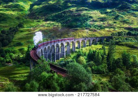 Glenfinnan Railway Viaduct in Scotland with the Jacobite steam train passing over. Artistic vintage style processing.