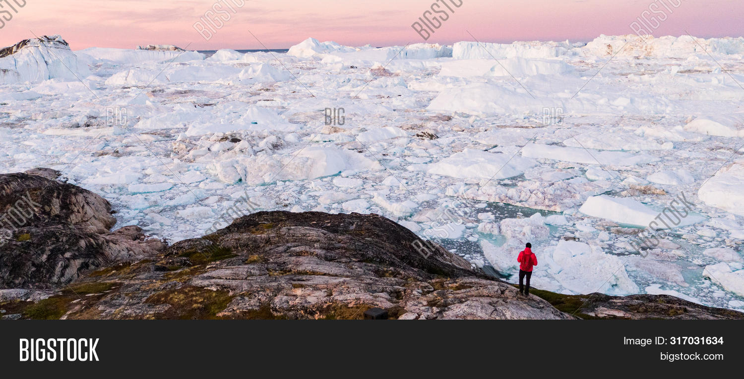 adventure,aerial,arctic,banner,change,climate,climate change,cold,destination,environment,fjord,giant,glacier,global,global warming,greenland,hiking,ice,iceberg,icebergs,icefjord,ilulissat,jakobshavn,landscape,looking,man,melting,nature,north,ocean,outdoors,panorama,panoramic,person,polar,scientist,sea,standing,summer,tourism,tourist,tourists,travel,traveler,view,warming,water,white