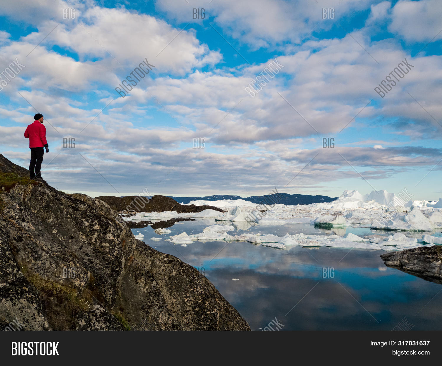 adventure,aerial,arctic,change,climate,climate change,cold,destination,environment,fjord,floating,floe,giant,glacier,global,global warming,greenland,hiking,ice,iceberg,icebergs,icefjord,ilulissat,jakobshavn,landscape,looking,man,melting,nature,north,ocean,outdoors,person,polar,researcher,scientist,sea,standing,summer,tourism,tourist,tourists,travel,traveler,view,warming,water,white