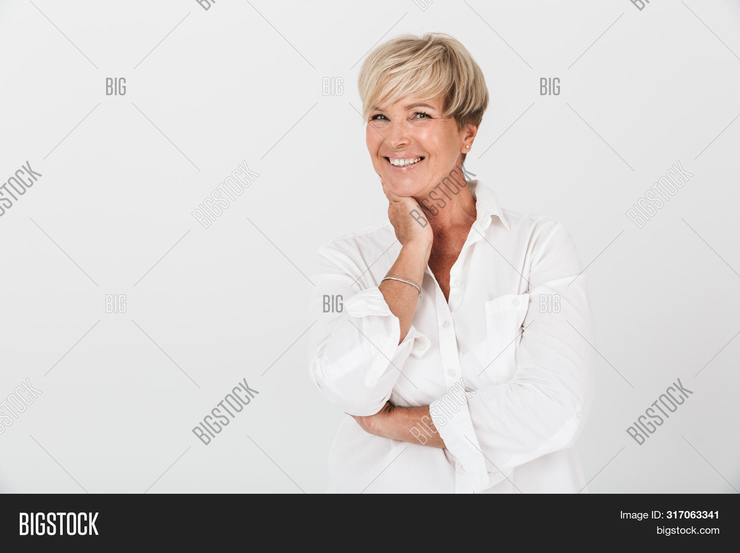 aged,amazed,appearance,attractive,background,beautiful,blond,caucasian,charming,closeup,confident,copyspace,elegant,emotions,expressions,facial,female,gorgeous,grandmother,gray,grown,hair,happy,indoors,isolated,joyous,laughing,looking,mature,middle,model,mother,nice,older,one,optimistic,person,portrait,posing,positive,short,smiling,standing,studio,white,woman