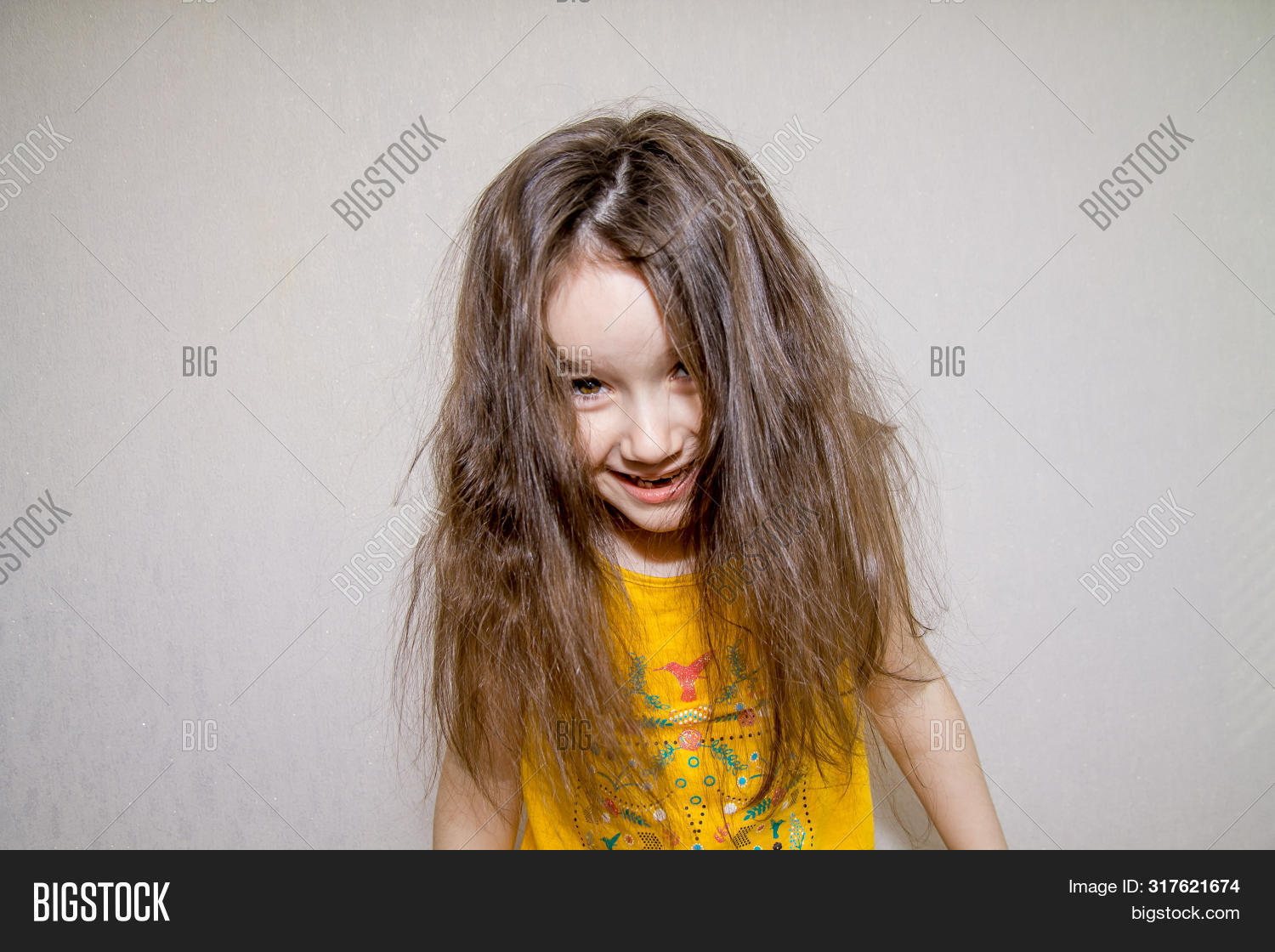 Portrait Of A Little Mope-headed Agressive Angry Girl Screaming On White Background