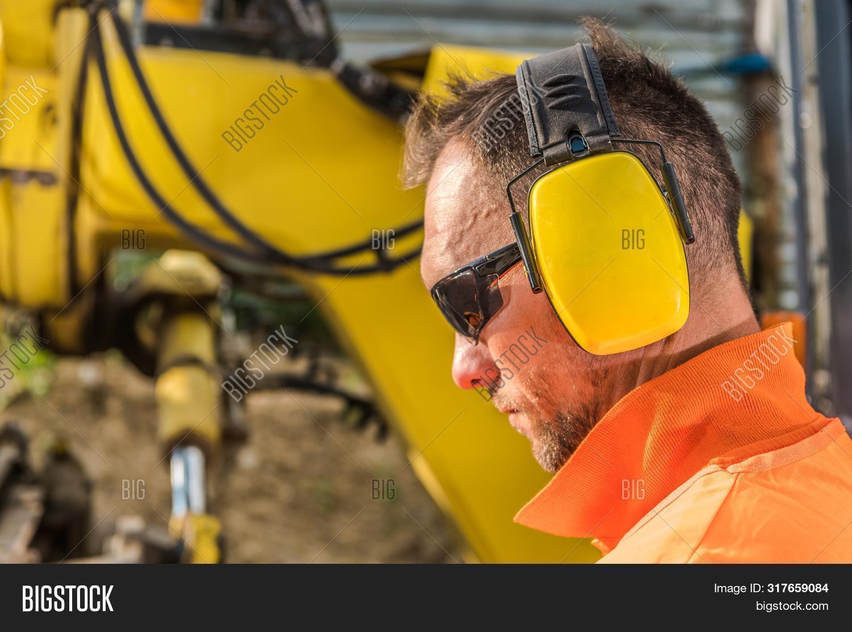 caucasian,contractor,equipment,headphones,headset,hear,hearing,industrial,industry,job,labor,men,noise,operator,protection,reduction,secure,sunglasses,worker