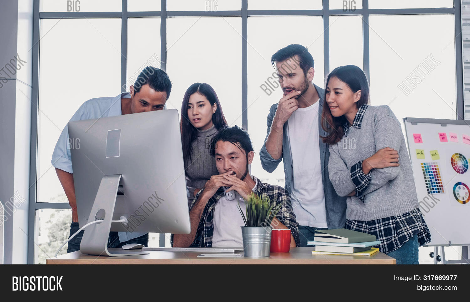 Creative Director Team Waiting For Good News Of Project With Designer At Table With Desktop Computer