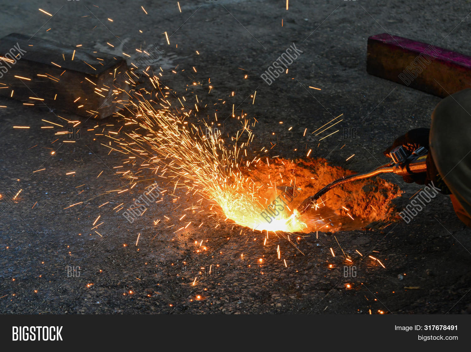 A Gas Cutter In Production, A Welder Removes Unnecessary Metal Residues With A Gas Cutter, Sparks Fl