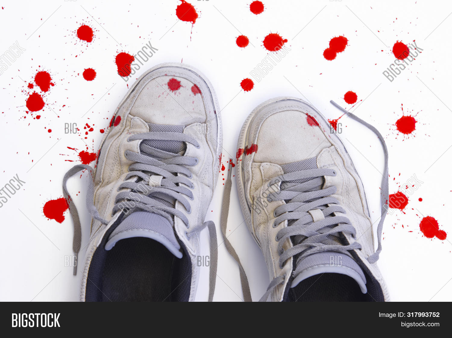 Used Sneakers With Blood Isolated On White. Violence Against Children