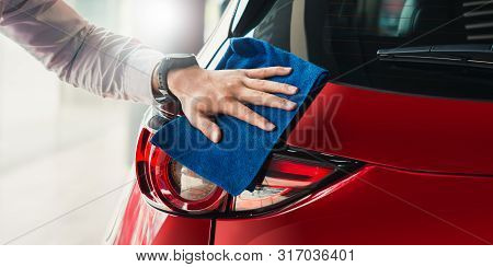 Man asian inspection headlamp and cleaning Equipment car wash With red car For cleaning to quality to customer on car showroom of service transport automobile transportation automotive image. stock photo