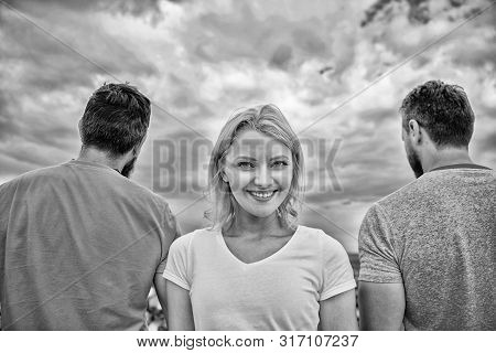 Girl stand in front two faceless men. Best traits of great boyfriend. She needs to pick better boyfriend. Everything you need to know about choosing right guy. Girl thinking whom she going ask dating stock photo