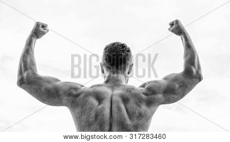 Sport motivation. Man celebrating success. Bodybuilder strong muscular back feeling powerful and superior. Achieve success. Successful athlete. Victory and success. Champion and winner concept stock photo