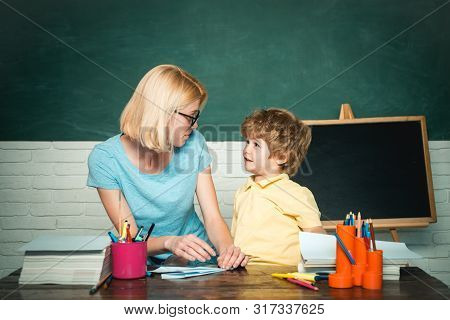 Boy And Girl From Elementary School At The School Yard. Education And Learning People Concept. Schoo
