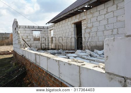 Bad construction destroys a house wall,  consruction defects from autoclaved aerated concrete blocks, brick wall failure. Poorly built house stock photo