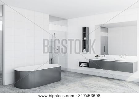 Interior of luxury bathroom with white tile walls, concrete floor, comfortable gray bathtub and shower stall with glass doors. 3d rendering stock photo