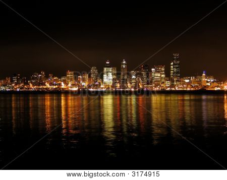 Reflection of Seattle Skyline Viewed from Alki Beach stock photo