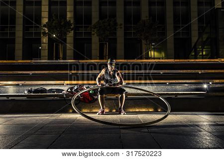 cyr wheel performance session at night in Riga. stock photo