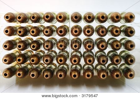 Hollowpoint detail of an array of bullets in a plastic case holder stock photo