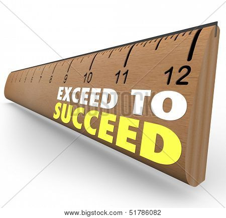 The words Exceed to Succeed on a wooden ruler from school to illustrate getting extra credit or going above and beyond expections to achieve success stock photo