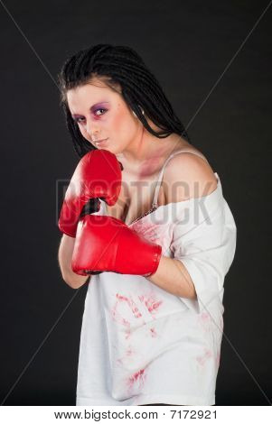 white girl boxer with red muffler on black background stock photo