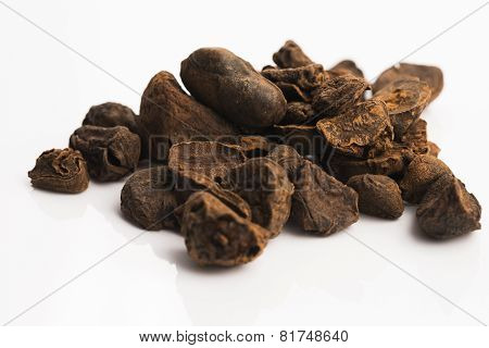 Cola nuts on white background. close - up stock photo