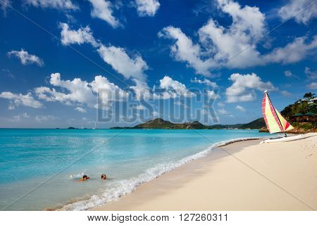 Idyllic tropical beach with white sand, turquoise ocean water and blue sky at Antigua island in Cari