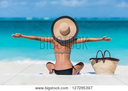 Summer vacation happy carefree joyful bikini woman arms outstretched in happiness enjoying tropical