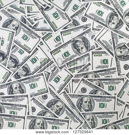 Background from a variety of hundred-dollar bills. Many money. Dollars background. Fake money.