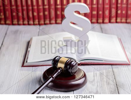 Symbols of law in court library. Judge gavel wooden paragraph and legal codes. Law concept stock photo