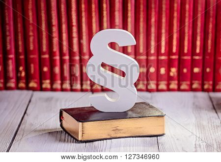 White wooden paragraph the symbol of law in court library with legal codes. Law concept stock photo