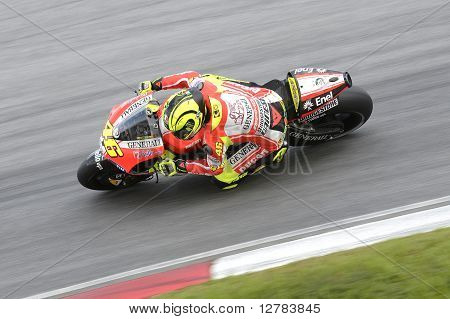 SEPANG MALAYSIA - FEB 3 : Ducati Team rider Valentino Rossi of Italy in action during the 2011 pre-season test at Sepang circuit February 3 2011 in Sepang Malaysia. stock photo