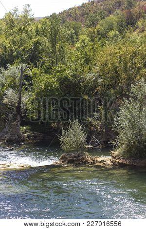 STUDENCI, BOSNIA AND HERZEGOVINA: The natural park surrounding Kravica waterfalls in Bosnia Herzegovina stock photo