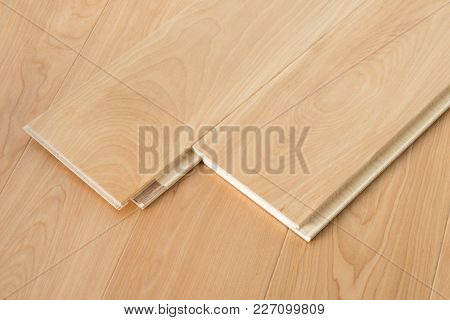 Natural wooden flooring parquet planks with lock joint stock photo