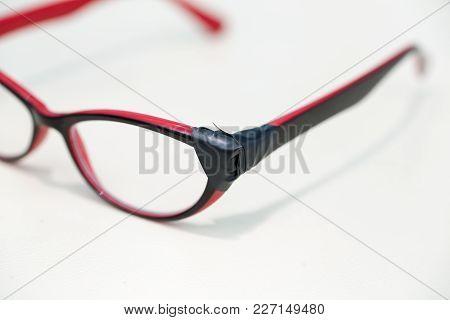 Broken red glasses on white background lie stock photo