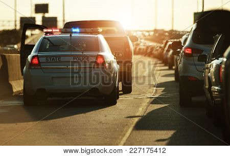 Police Traffic Stop. Policeman Stop Speeding Vehicle on the Side of the Highway. Chicago, Illinois, USA. stock photo
